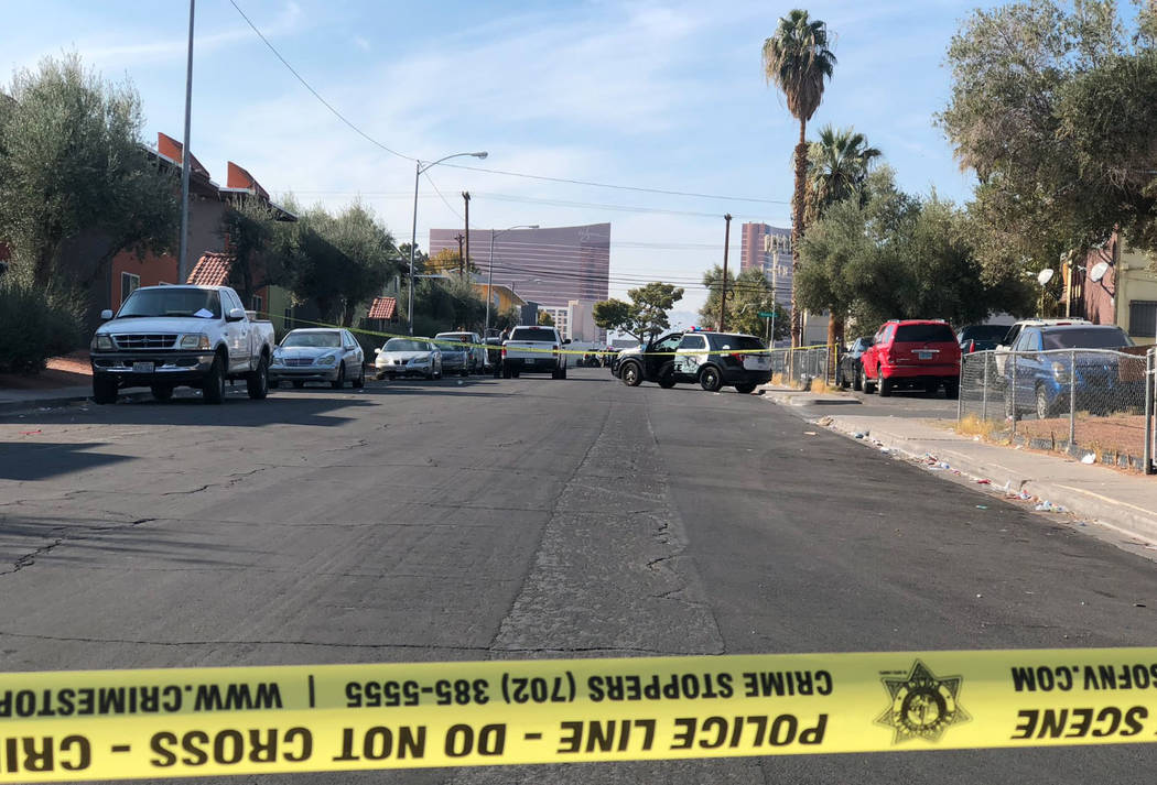 The perimeter of the crime scene spans several blocks, with yellow crime tape roping off multiple areas between Cambridge/Rome. The parking lot of a Shell gas station on the corner of Cambridge/De ...