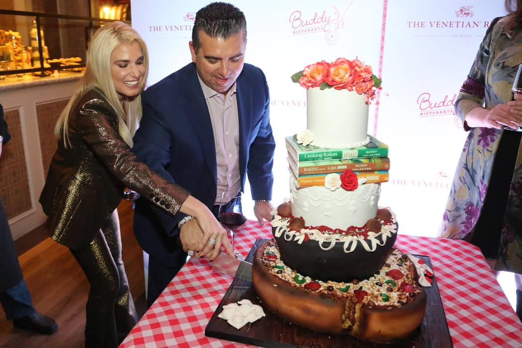 Buddy Valastro and his wife, Lisa, cut into a customized cake marking the fifth anniversary of Buddy V's at the Venetian's Grand Canal Shoppes on Thursday, Nov. 15, 2018. (Edison Graff)