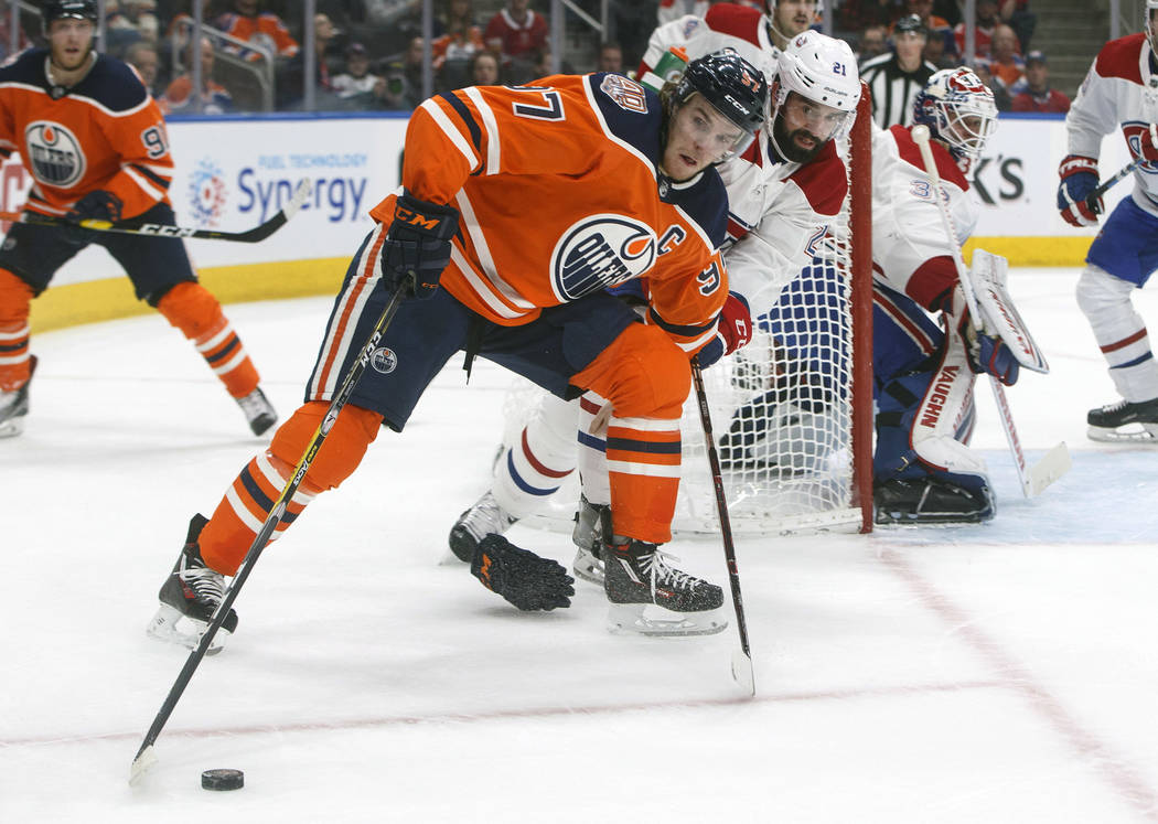 Montreal Canadiens' David Schlemko (21) chases Edmonton Oilers' Connor McDavid (97) during the second period of an NHL hockey game, Tuesday, Nov. 13, 2018 in Edmonton, Alberta. (Jason Franson/The ...
