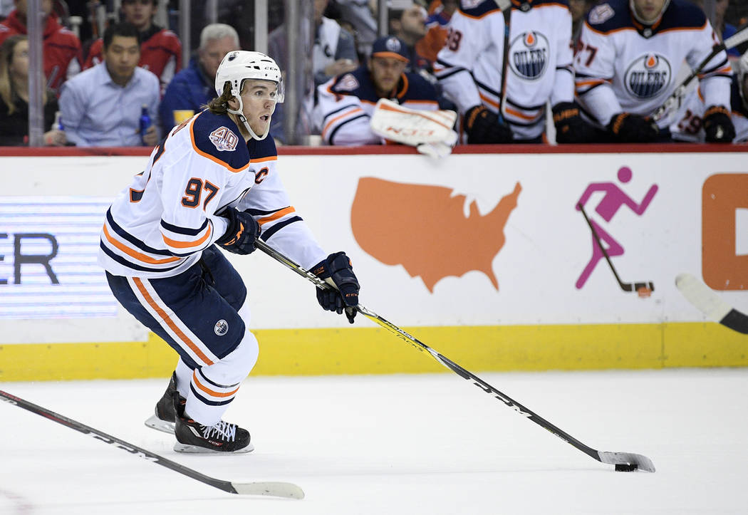 Edmonton Oilers center Connor McDavid (97) skates with the puck during the second period of an NHL hockey game against the Washington Capitals, Monday, Nov. 5, 2018, in Washington. (AP Photo/Nick ...