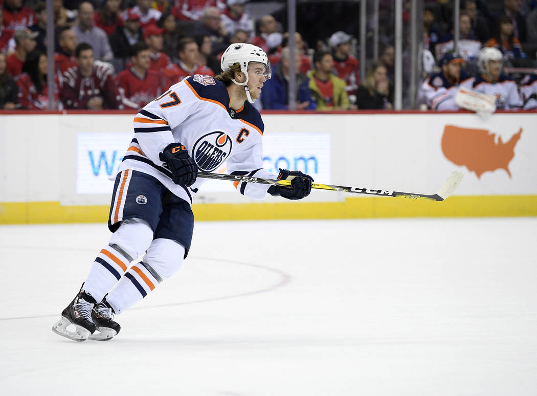 Edmonton Oilers center Connor McDavid (97) skates during the first period of an NHL hockey game against the Washington Capitals, Monday, Nov. 5, 2018, in Washington. (AP Photo/Nick Wass)