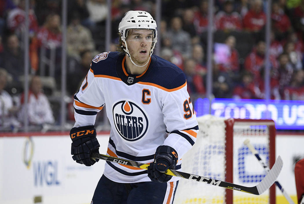 Edmonton Oilers center Connor McDavid (97) stands on the ice during the second period of an NHL hockey game against the Washington Capitals, Monday, Nov. 5, 2018, in Washington. (AP Photo/Nick Wass)