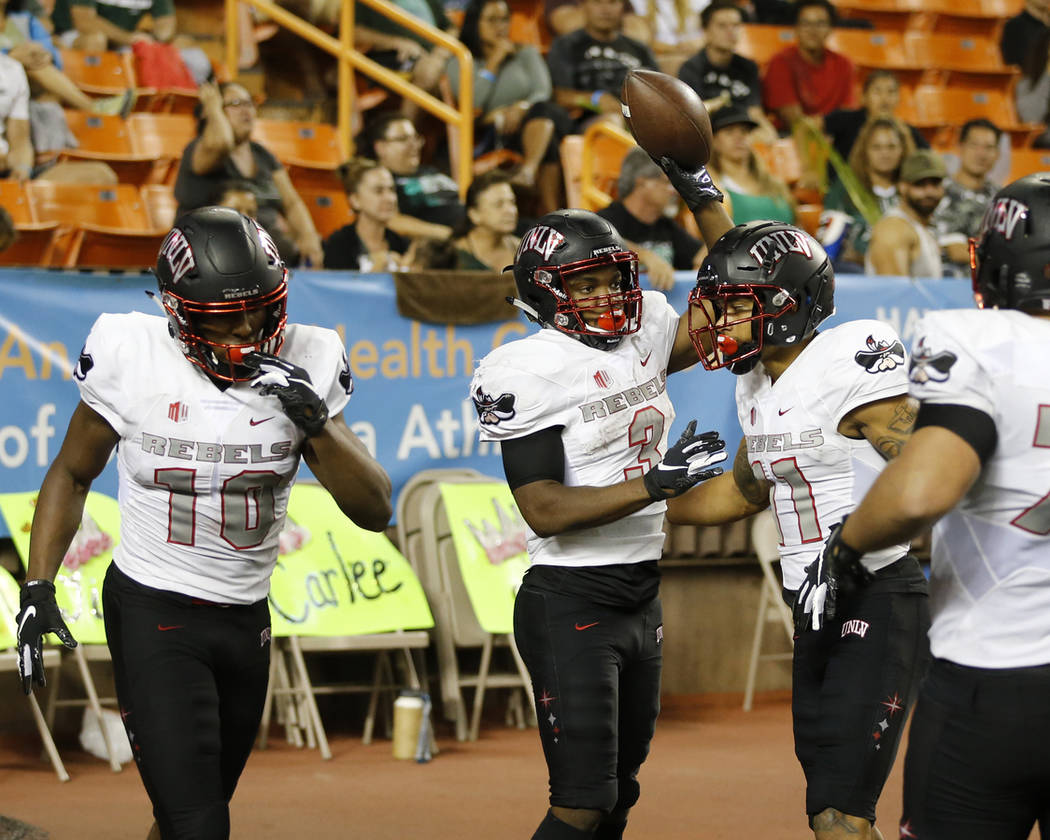 UNLV running back Lexington Thomas (3) after a second quarter touchdown against Hawaii during an NCAA college football game, Saturday, Nov. 17, 2018, in Honolulu. (AP Photo/Marco Garcia)