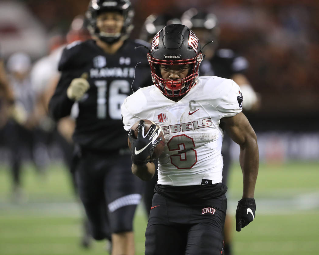 UNLV running back Lexington Thomas (3) runs the ball into the end zone during the second quarter of an NCAA college football game against Hawaii, Saturday, Nov. 17, 2018, in Honolulu. (AP Photo/Ma ...