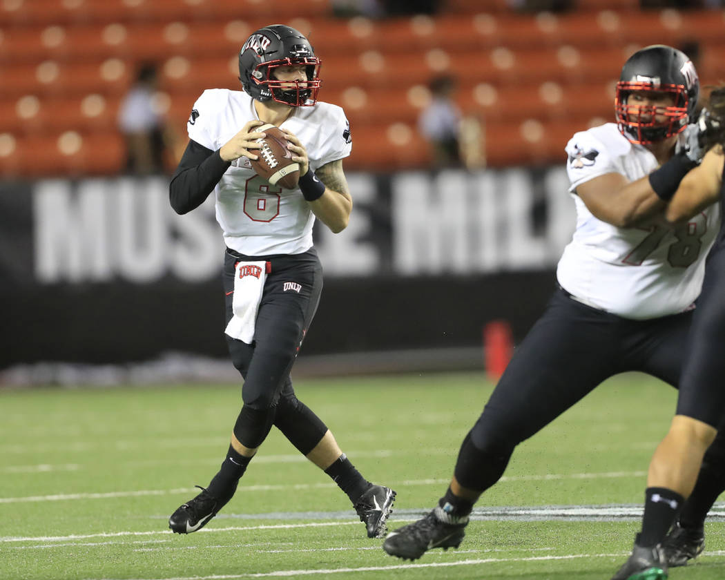 UNLV quarterback Max Gilliam (6) looks to make a pass against Hawaii during the first quarter of an NCAA college football game, Saturday, Nov. 17, 2018, in Honolulu. (AP Photo/Marco Garcia)