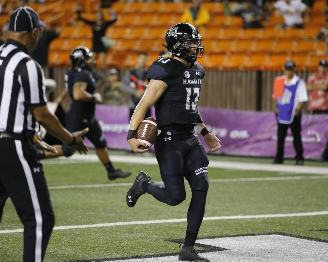 Hawaii quarterback Cole McDonald (13) runs in a touchdown against UNLV during the third quarter of an NCAA college football game, Saturday, Nov. 17, 2018, in Honolulu. (AP Photo/Marco Garcia)