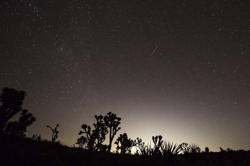 Las Vegas glows in the distance as a meteor streaks above the Mojave Desert before dawn on Sunday. Richard Brian/Las Vegas Review-Journal @vegasphotograph