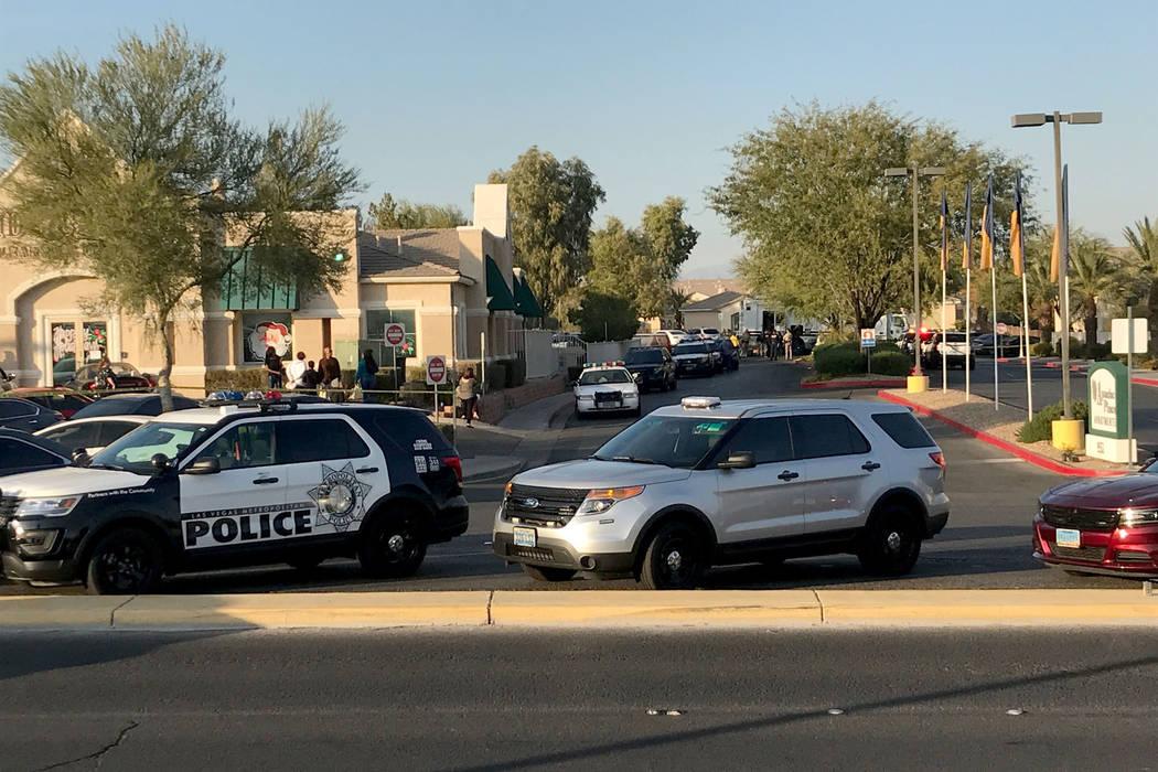Police cars fill the 9500 block of Tropicana Avenue, near Fort Apache Road. Erik Verduzco Las Vegas Review-Journal @Erik_Verduzco