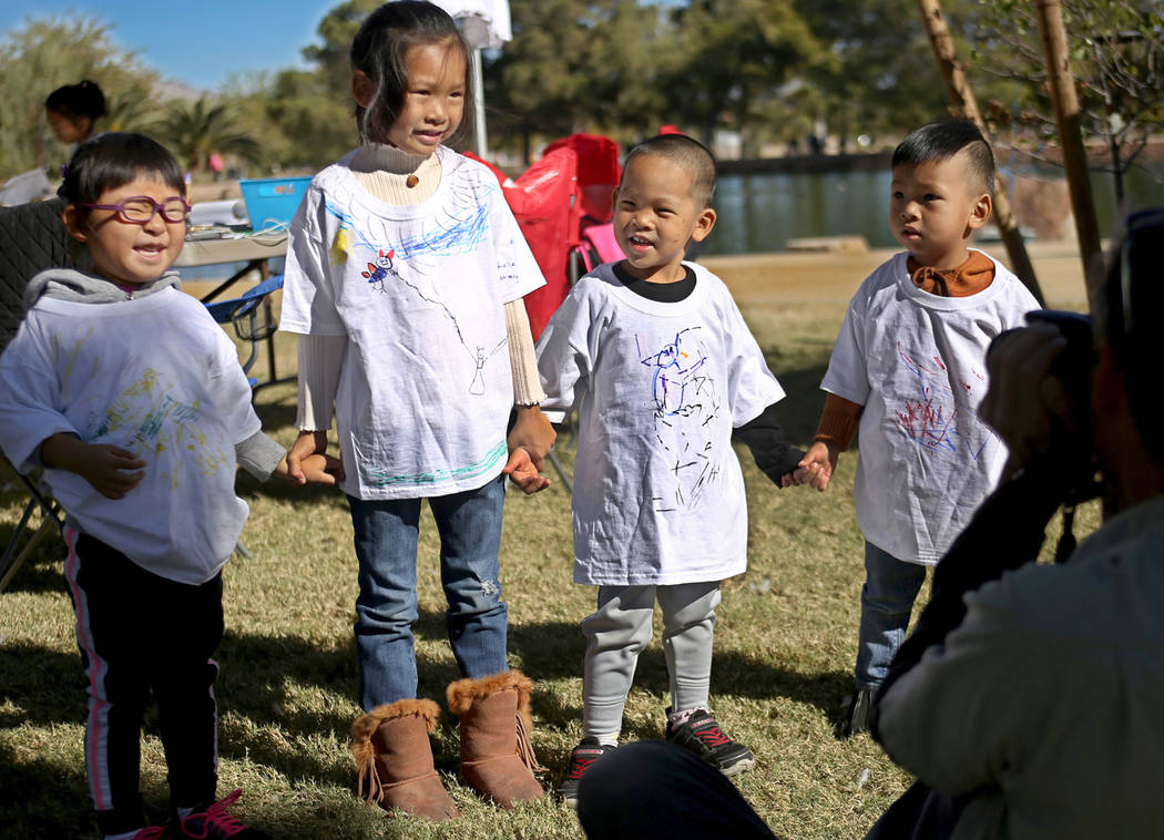 Josephine Huang, 4, from left, her cousin Adelle Huang, 5, her brother Davin Huang, 3, and other cousin Aden Huang, 2, pose with their hand drawn t-shirts at Migratory Bird Day at Sunset Park in L ...
