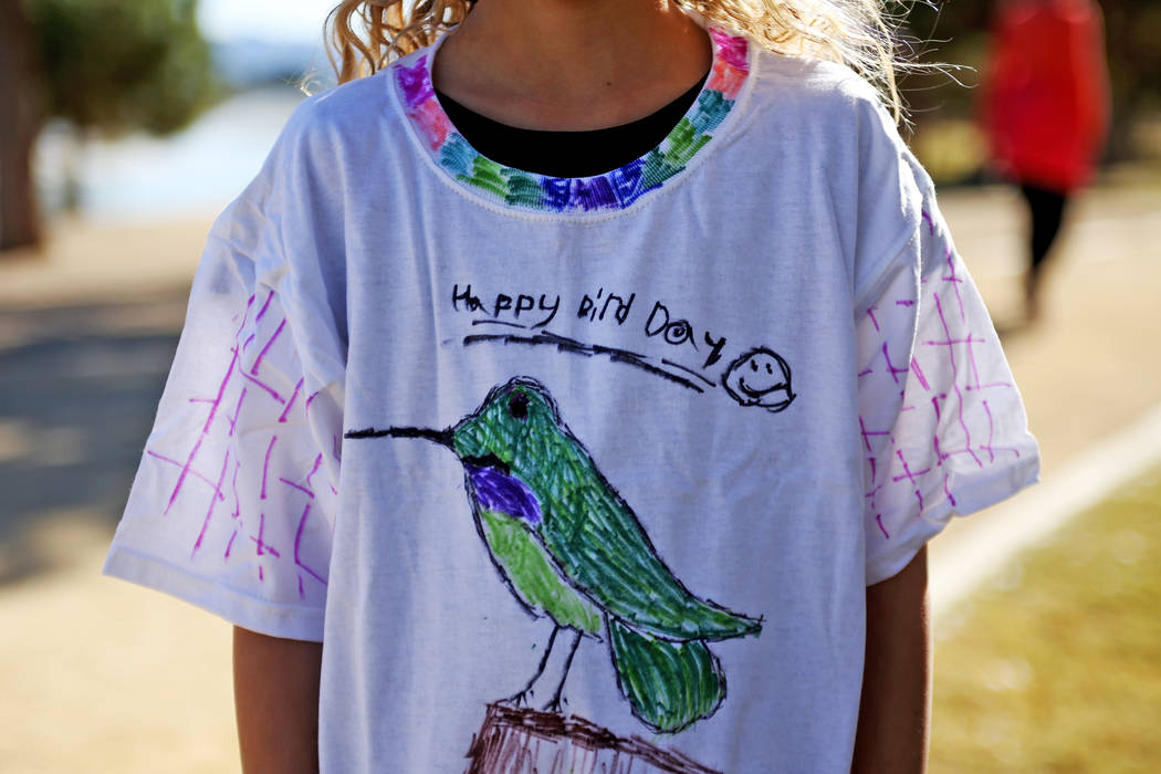 Jenna Hallmark, 9, shows off her hand drawn shirt at Migratory Bird Day at Sunset Park in Las Vegas, Sunday, Nov. 18, 2018. Different organizations offered activities for kids and adults to learn ...