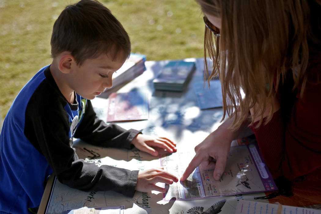 Ben Egosi, 4, learns about hiking and other outdoor activities at the Get Outdoors Nevada booth at Migratory Bird Day at Sunset Park in Las Vegas, Sunday, Nov. 18, 2018. Different organizations of ...