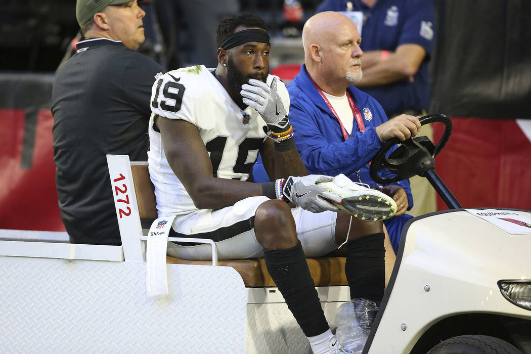 Oakland Raiders wide receiver Brandon LaFell (19) is carted off the field after an injury against the Arizona Cardinals during the second half of an NFL football game, Sunday, Nov. 18, 2018, in Gl ...