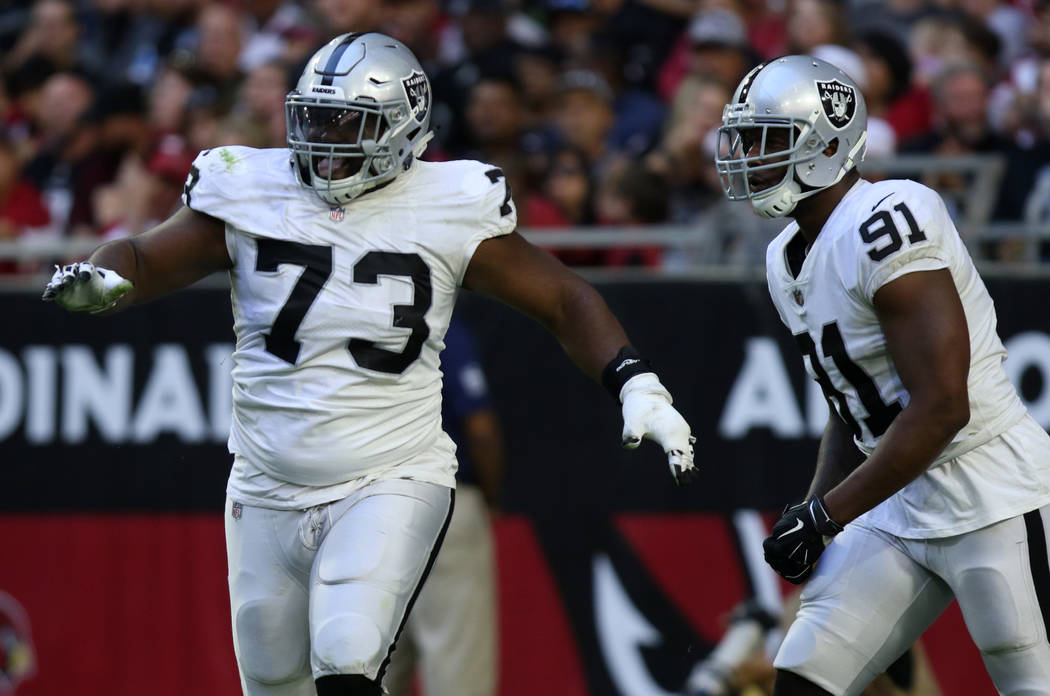 Oakland Raiders defensive tackle Maurice Hurst (73) celebrates his sack of Arizona Cardinals quarterback Josh Rosen (3), not pictured, with defensive end Shilique Calhoun (91) during the first hal ...