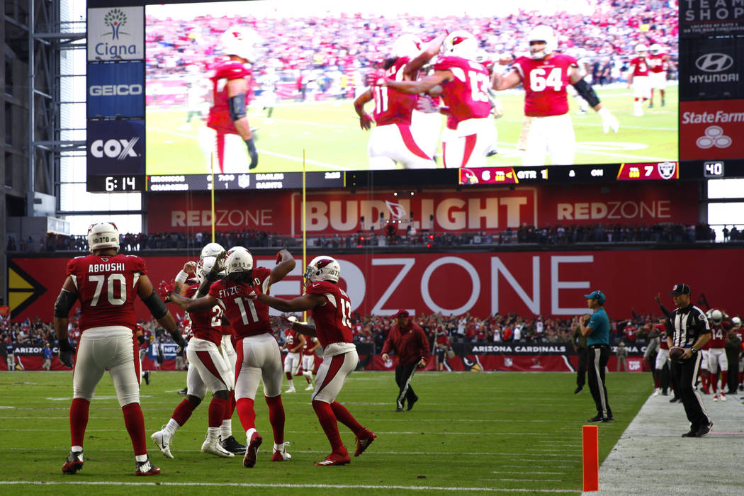 Arizona Cardinals wide receiver Larry Fitzgerald (11) celebrates his touchdown with wide receiver Christian Kirk (13), offensive guard Oday Aboushi (70) and running back Chase Edmonds (29) during ...