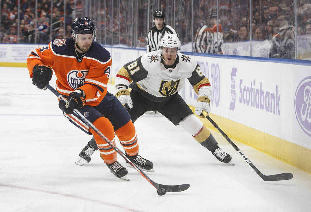Vegas Golden Knights' Jonathan Marchessault (81) chases Edmonton Oilers' Kris Russell (4) during first period NHL hockey action in Edmonton, Alberta, on Sunday Nov. 18, 2018. (Jason Franson/The Ca ...