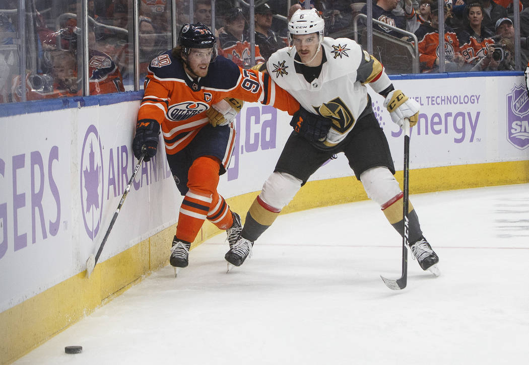 Vegas Golden Knights' Colin Miller (6) and Edmonton Oilers' Connor McDavid (97) race for the puck during the second period of an NHL hockey game Sunday, Nov. 18, 2018, in Edmonton, Alberta. (Jason ...