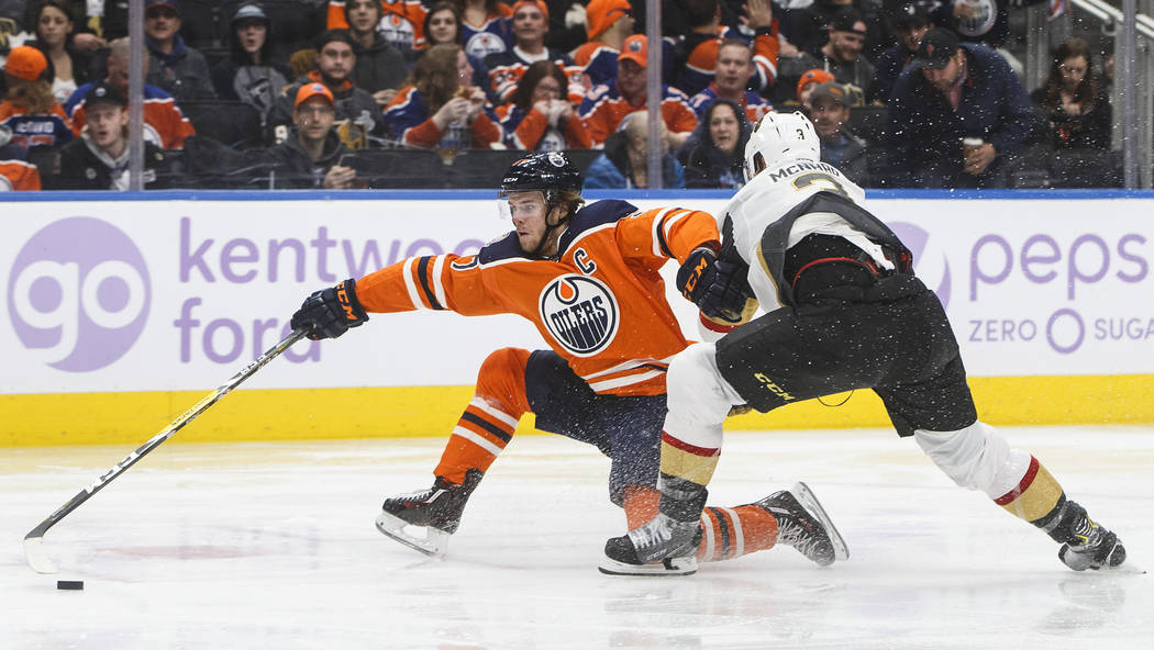 Vegas Golden Knights' Brayden McNabb (3) tries to stop Edmonton Oilers' Connor McDavid (97) during the second period of an NHL hockey game Sunday, Nov. 18, 2018, in Edmonton, Alberta. (Jason Frans ...