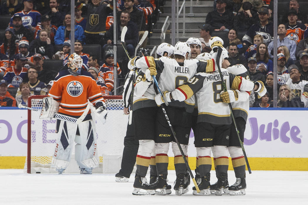 Vegas Golden Knights celebrate a goal against Edmonton Oilers goalie Cam Talbot, left, during the second period of an NHL hockey game Sunday, Nov. 18, 2018, in Edmonton, Alberta. (Jason Franson/Th ...