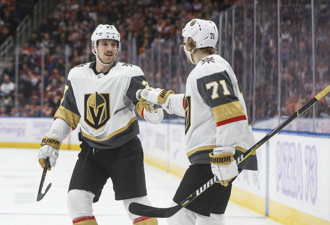 Vegas Golden Knights' Shea Theodore (27) and William Karlsson (71) celebrate a goal against the Edmonton Oilers during the first period of an NHL hockey game Sunday, Nov. 18, 2018, in Edmonton, Al ...