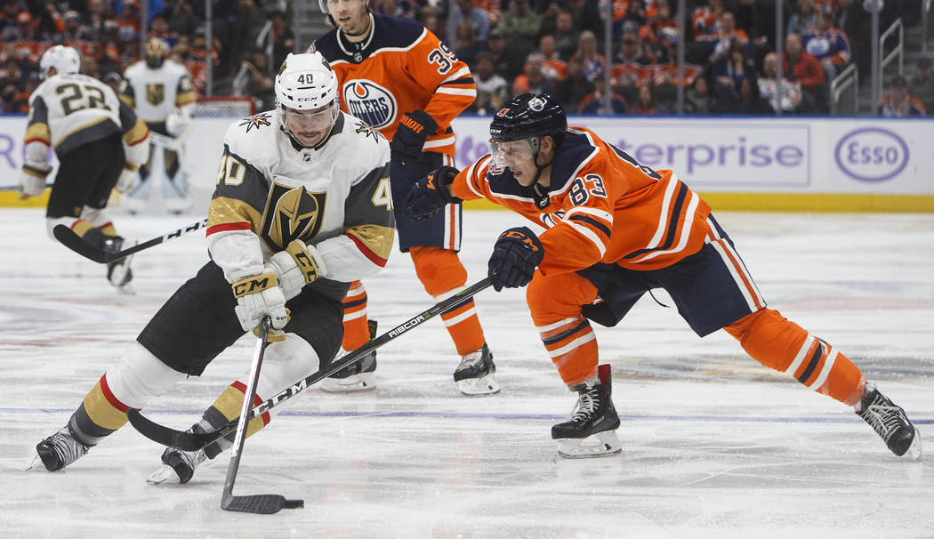 Vegas Golden Knights' Ryan Carpenter (40) is chased by Edmonton Oilers' Matthew Benning (83) during the third period of an NHL hockey game Sunday, Nov. 18, 2018, in Edmonton, Alberta. (Jason Frans ...
