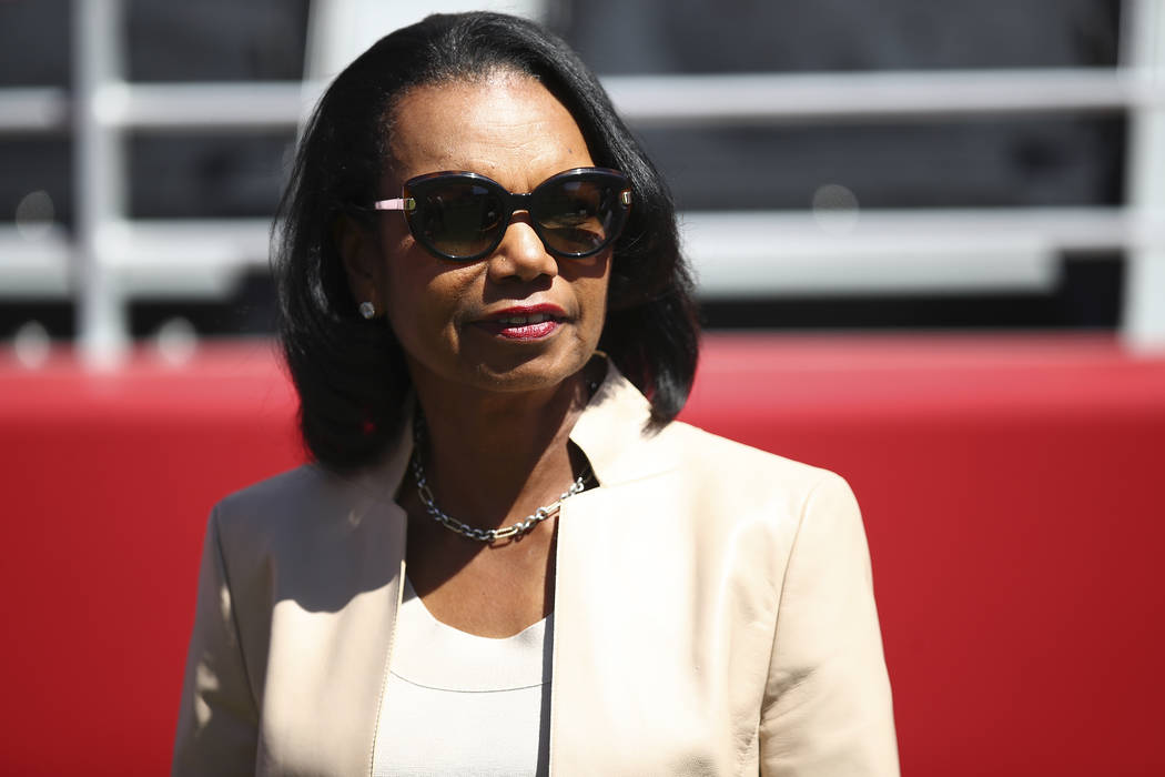 In this Sept. 16, 2018, file photo former Secretary of State Condoleezza Rice stands on the sidelines before the start of an NFL football game between the San Francisco 49ers and the Detroit Lions ...