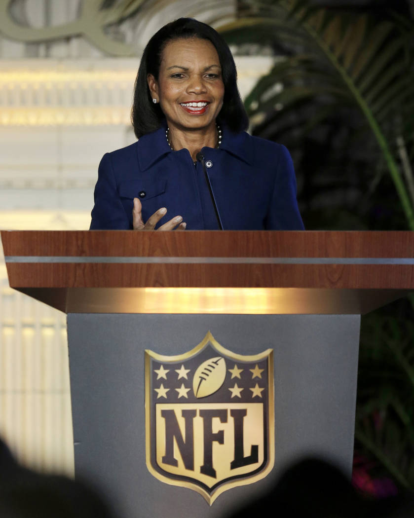 In this Feb. 4, 2016, file photo former U.S. Secretary of State Condoleezza Rice gestures while speaking at the NFL Women's Summit in San Francisco. (AP Photo/Ben Margot, File)