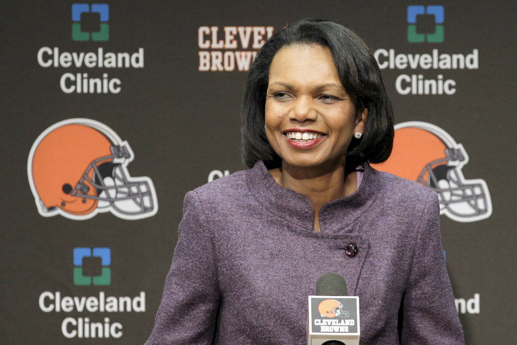 In this Oct. 21, 2010, file photo former Secretary of State Condoleezza Rice talks with the media after visiting with the Cleveland Browns coaches and players at the Browns training facility in Be ...