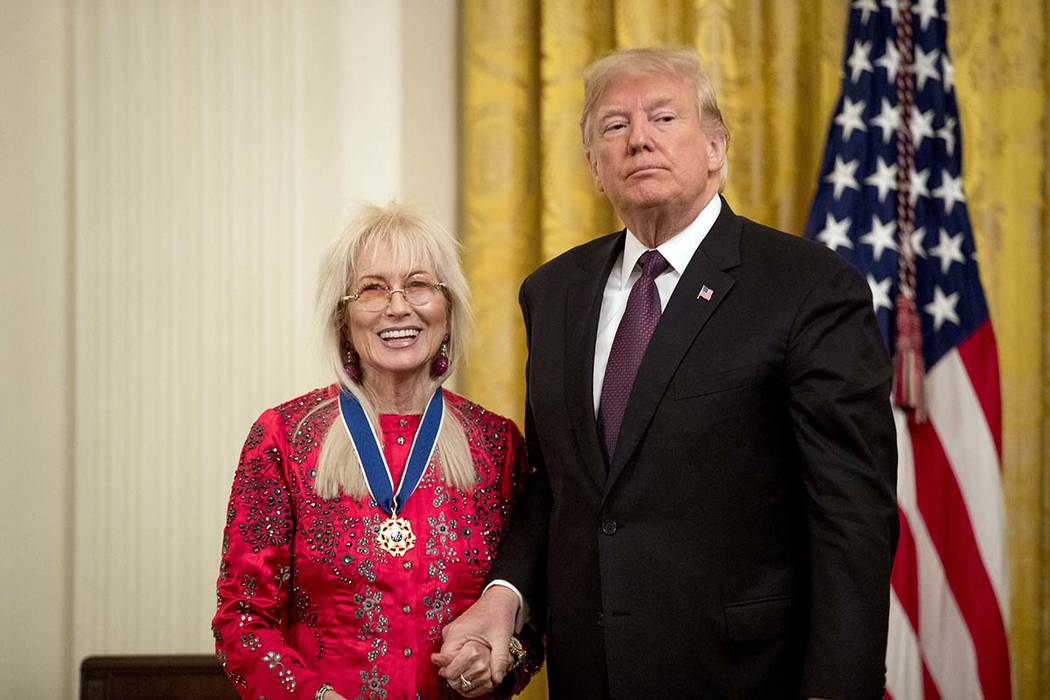 President Donald Trump awards Miriam Adelson the Medal of Freedom during a ceremony in the East Room of the White House in Washington, Friday, Nov. 16, 2018. (AP Photo/Andrew Harnik)