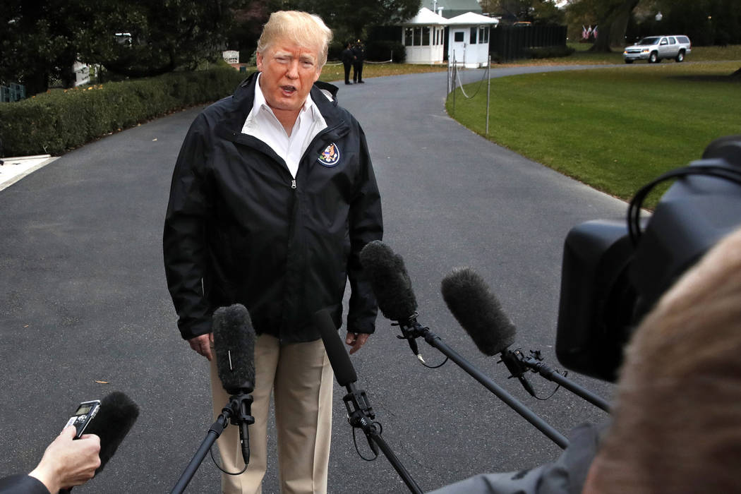 President Donald Trump answers questions from members of the media as he leaves the White House, Saturday Nov. 17, 2018, in Washington, en route to see fire damage in California. (AP Photo/Jacquel ...