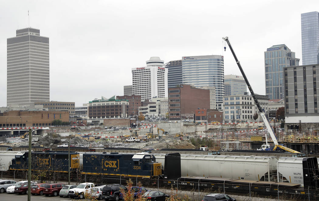 Construction work goes on in Nashville Yards, a 15-acre, mixed-use downtown development area in Nashville, Tenn. (AP Photo/Mark Humphrey)