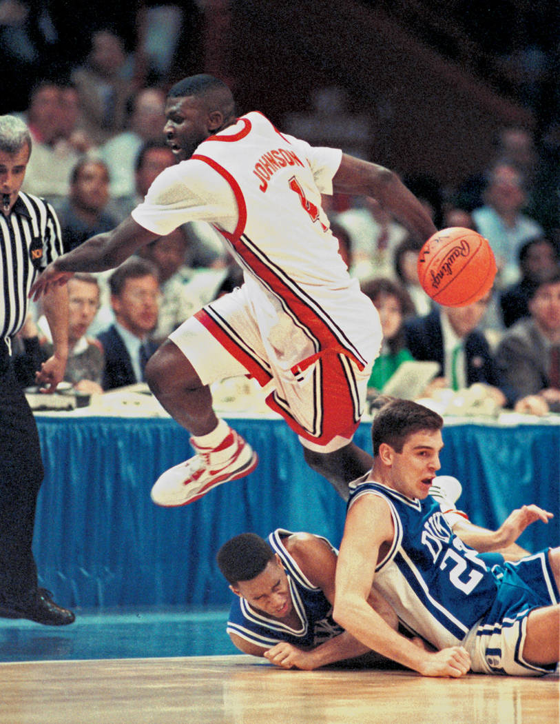 UNLV Rebels forward Larry Johnson (4) performs a behind the back pass during the NCAA Men's basketball championship game against the Duke Blue Devils in Denver, Colo., April 2, 1990. The Rebels we ...