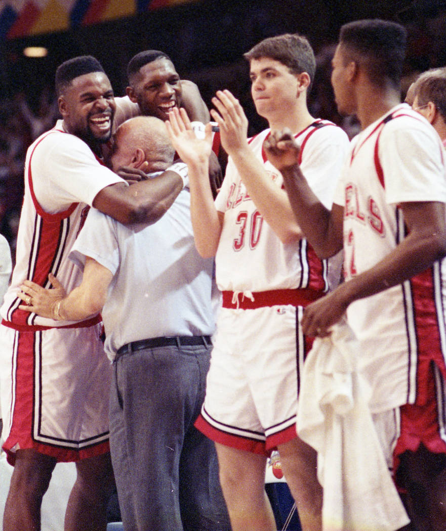 UNLV basketball players celebrate with head coach Jerry Tarkanian after their NCAA National Championship win over the Duke Blue Devils on April 2, 1990. (Review-Journal File)