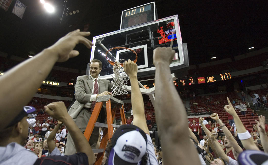 UNLV Head Coach Lon Kruger takes down the net after the Rebels' 78-70 victory over BYU in their Mountain West Conference Championship game at the Thomas & Mack Center Saturday, March 10, 2007. ...