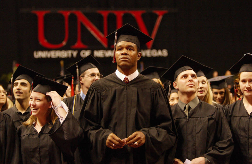 Randall Cunningham, who spent 16 seasons in the NFL as a quarterback with Philadephia, Minnesota, Baltimore, and Dallas, stands with other UNLV graduates at the Thomas & Mack Center in Las Veg ...