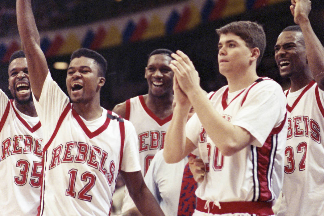 Mosses Scurry, left, Anderson Hunt, David Butler, David Rice, Stacey Augmon, and Jerry Tarkanian in the middle (hidden) celebrate after winning the NCAA National Championship against the Duke Blue ...