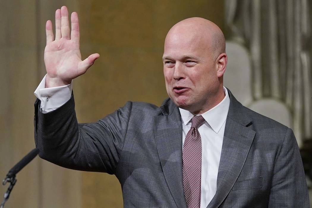 Acting Attorney General Matthew Whitaker gestures after speaking at the Department of Justice's Annual Veterans Appreciation Day Ceremony, Thursday, Nov. 15, 2018, at the Justice Department in Was ...