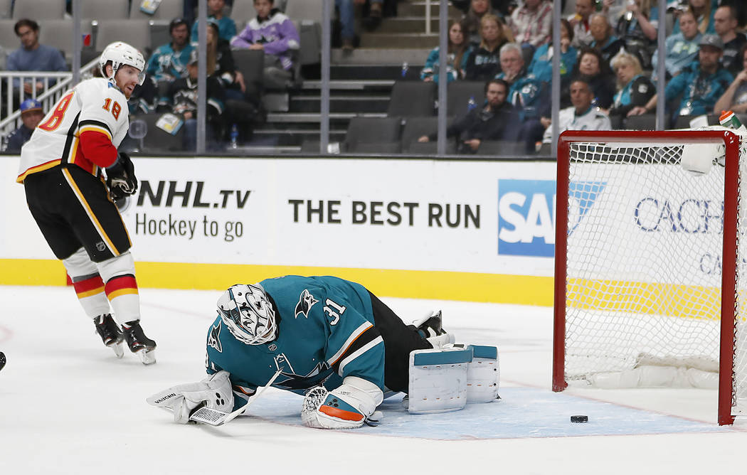 Calgary Flames left wing James Neal (18) looks back after scoring a goal past San Jose Sharks goaltender Martin Jones during the second period of a preseason NHL hockey game in San Jose, Calif., o ...