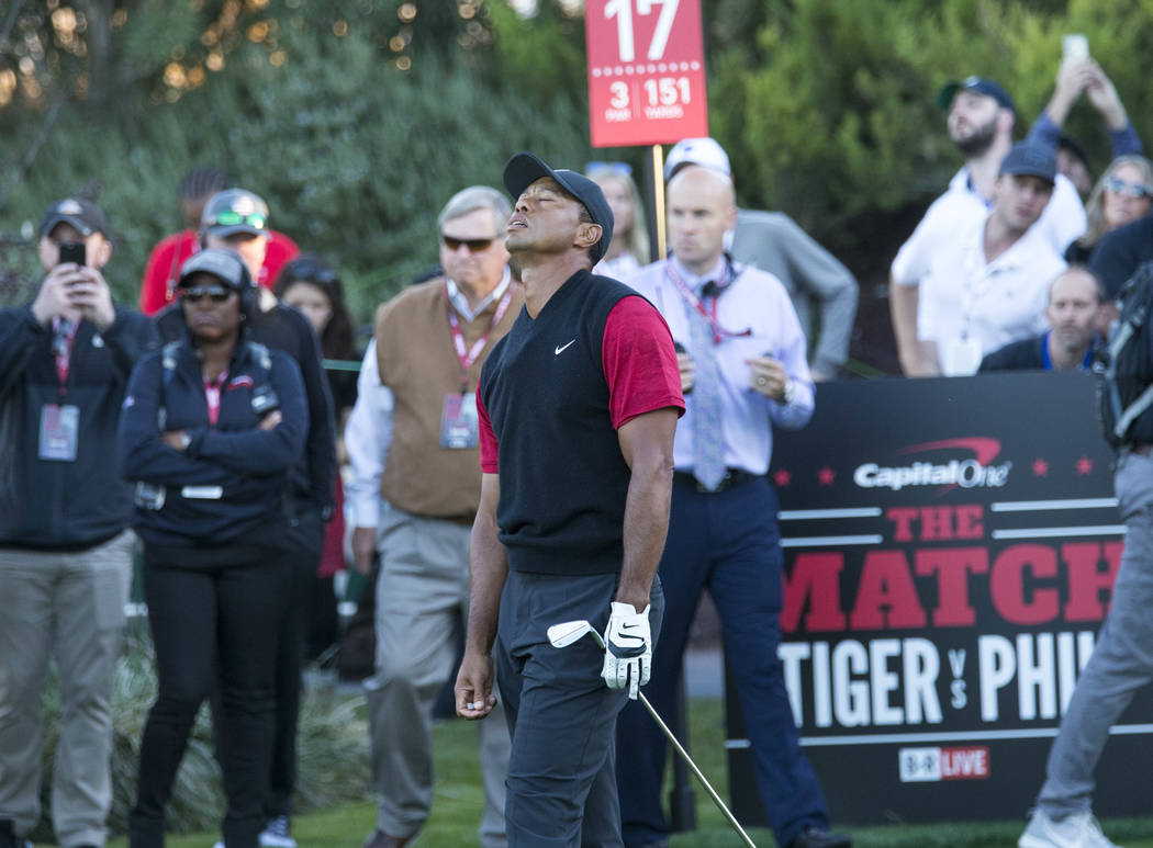Tiger Woods reacts to his shot from the 17th tee box during The Match at Shadow Creek Golf Course in North Las Vegas on Friday, Nov. 23, 2018. Richard Brian Las Vegas Review-Journal @vegasphotograph