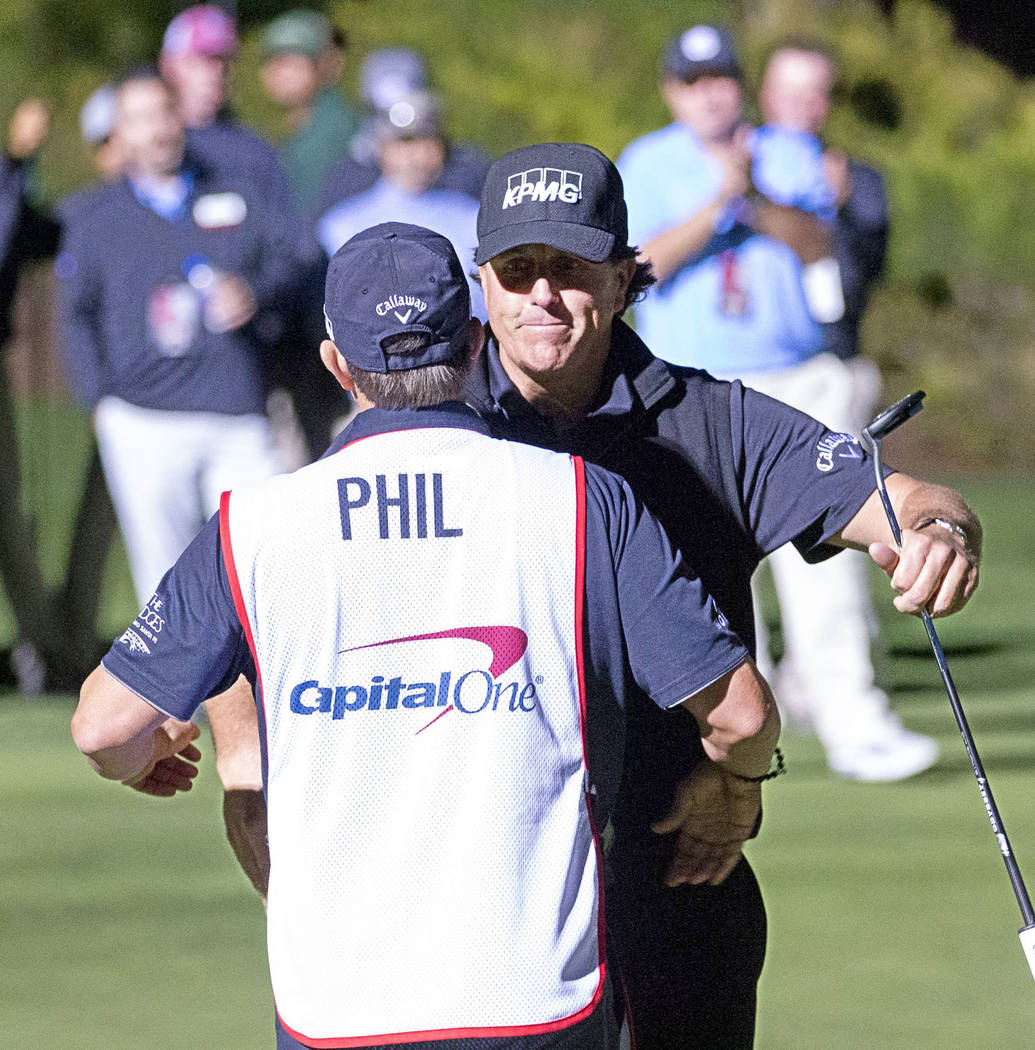 Phil Mickelson hugs his caddie after defeating Tiger Woods in The Match at Shadow Creek Golf Course in North Las Vegas on Friday, Nov. 23, 2018. Richard Brian Las Vegas Review-Journal @vegasphotograph