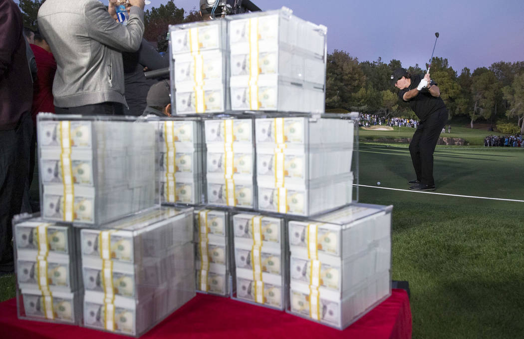 The $9 million prize is seen in the foreground as Phil Mickelson tees off before winning The Match at Shadow Creek Golf Course in North Las Vegas on Friday, Nov. 23, 2018. Richard Brian Las Vegas ...