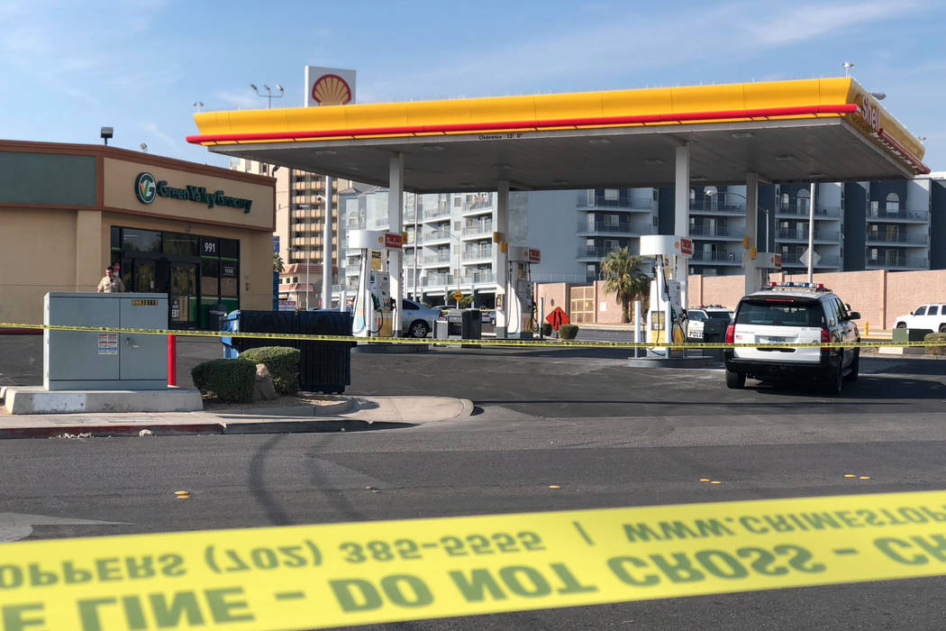 The perimeter of the crime scene spans several blocks, with yellow crime tape roping off multiple areas between Cambridge and Rome streets, Saturday, Nov. 17, 2018. The parking lot of a Shell gas ...