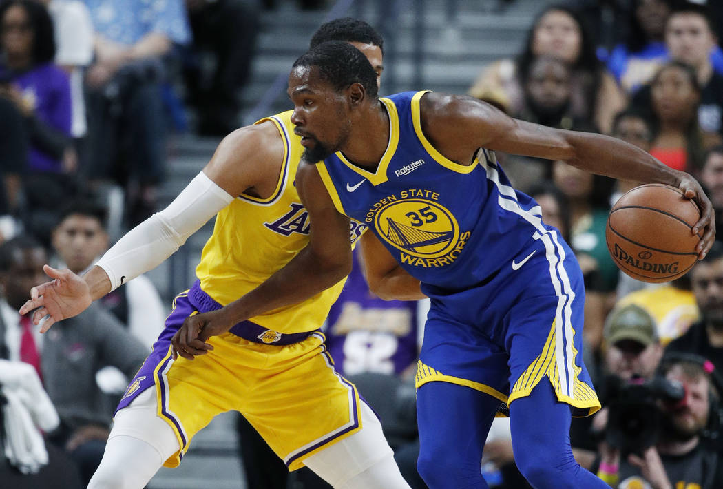 Golden State Warriors forward Kevin Durant drives against Los Angeles Lakers guard Josh Hart during the first half of an NBA preseason basketball game Wednesday, Oct. 10, 2018, in Las Vegas. (AP P ...