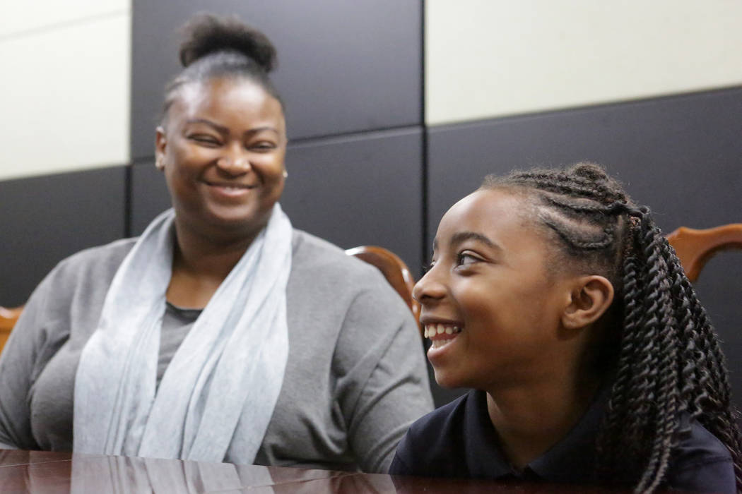 Suddenly Crosby, left, smiles with her daughter Jaraya, 7, at Mountain View Christian School in Las Vegas on Friday, Nov. 16, 2018. The Opportunity Scholarship program helped Crosby attend the sch ...
