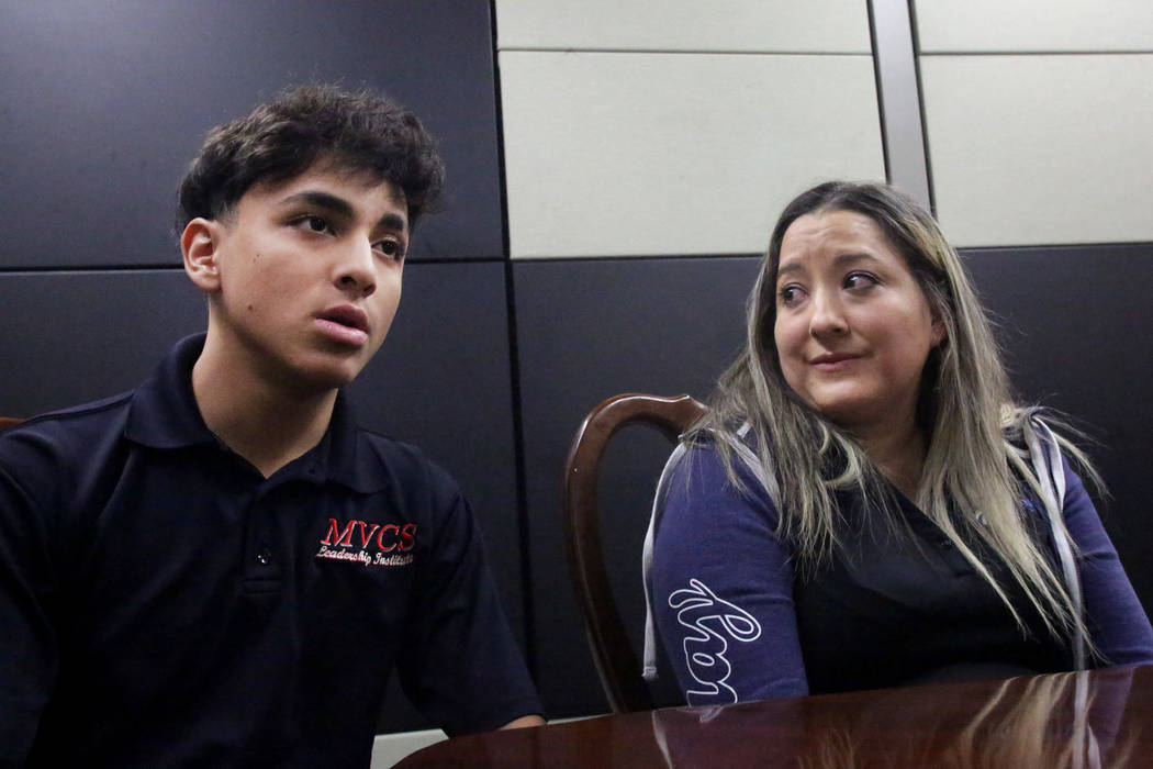 Jose Diaz, left, speaks while his mother, Rosa, looks on at Mountain View Christian School in Las Vegas on Friday, Nov. 16, 2018. The Opportunity Scholarship program helped Jose attend the school. ...