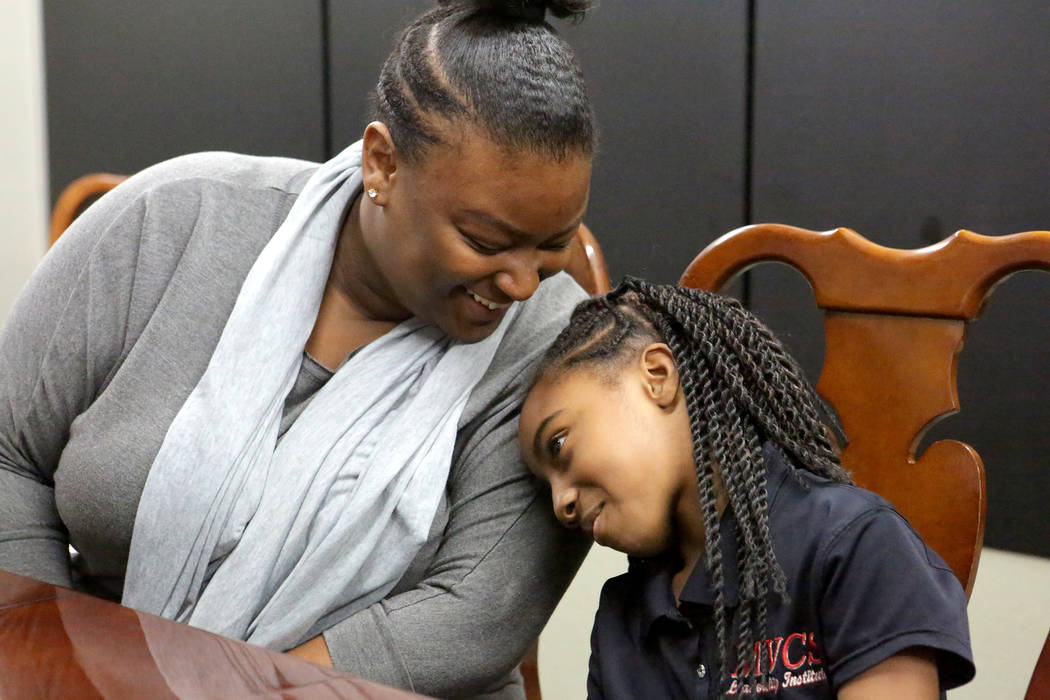 Suddenly Crosby, left, talks with her daughter Jaraya, 7, at Mountain View Christian School in Las Vegas on Friday, Nov. 16, 2018. The Opportunity Scholarship program helped Crosby attend the scho ...