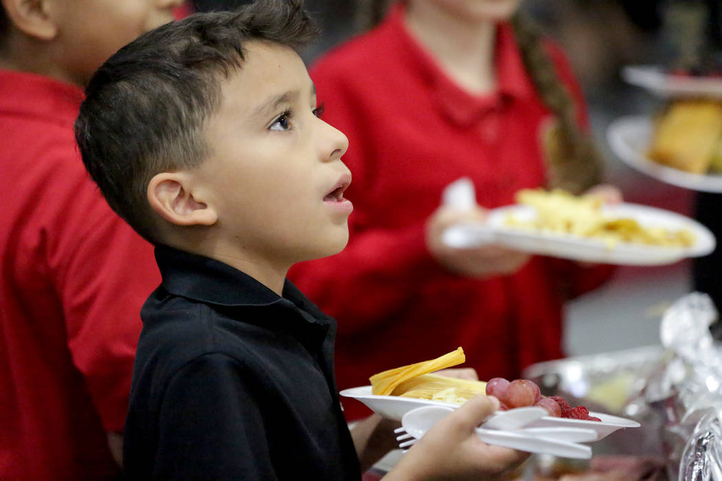 Angel Diaz, 8, fills his plate during a Thanksgiving potluck at Mountain View Christian School in Las Vegas on Friday, Nov. 16, 2018. Angel attends the school with help from the Opportunity Schola ...