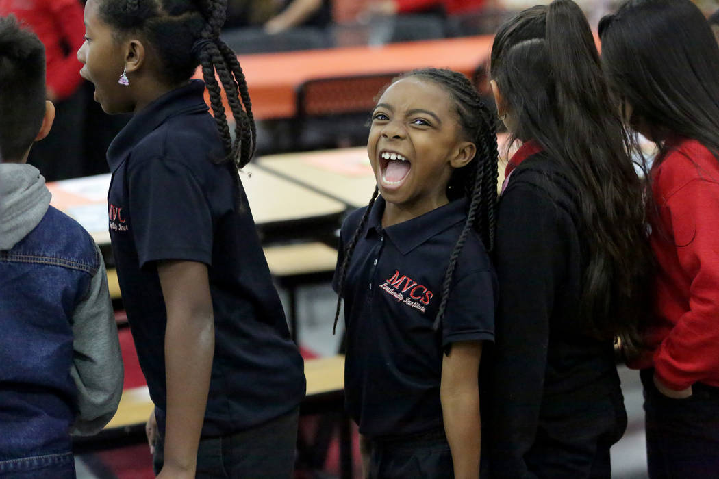 Jaraya Crosby, 7, waits in line during a Thanksgiving potluck at Mountain View Christian School in Las Vegas on Friday, Nov. 16, 2018. The Opportunity Scholarship program helped Jaraya attend the ...