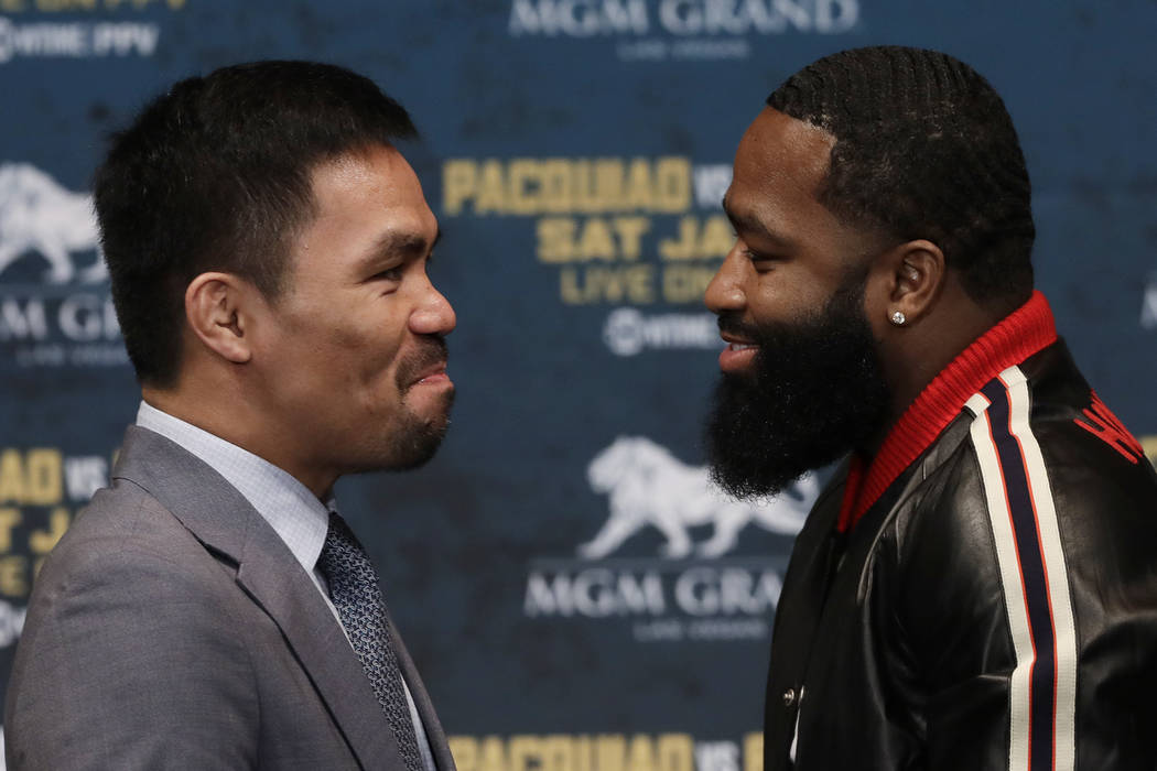 Manny Paquiao, left, and Adrien Broner attend a news conference, Monday, Nov. 19, 2018, in New York. Paquiao will defend his World Boxing Association welterweight title against Broner on Jan. 19, ...