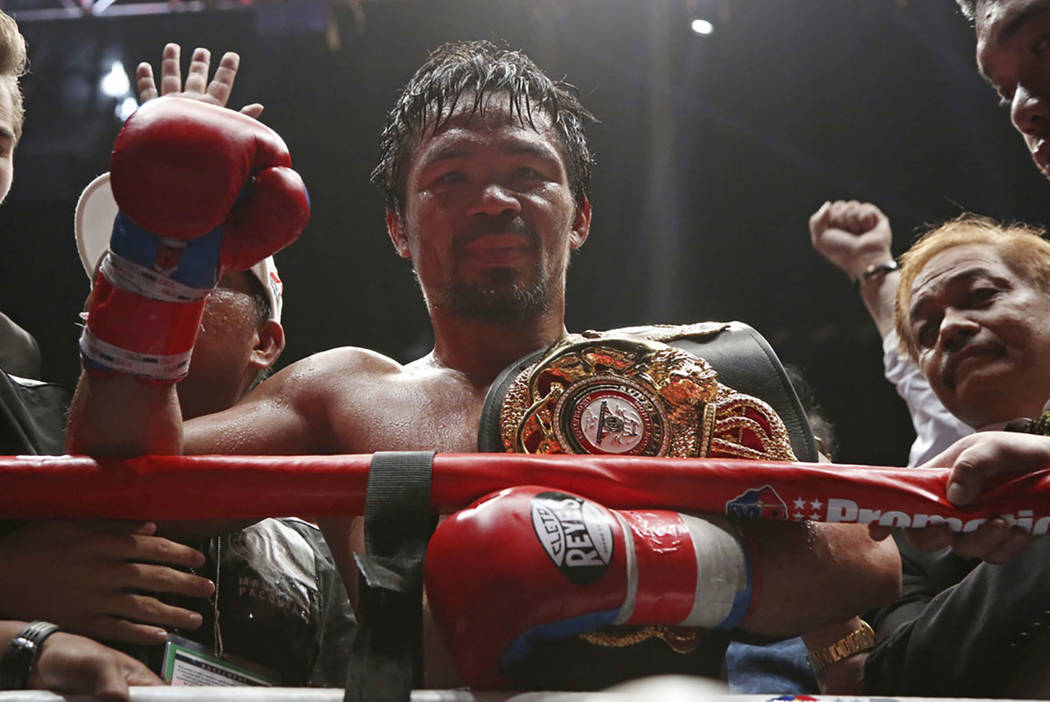 Manny Pacquiao of the Philippines poses after defeating Lucas Matthysse of Argentina during their WBA World welterweight title bout in Kuala Lumpur, Malaysia, Sunday, July 15, 2018. Pacquiao won t ...