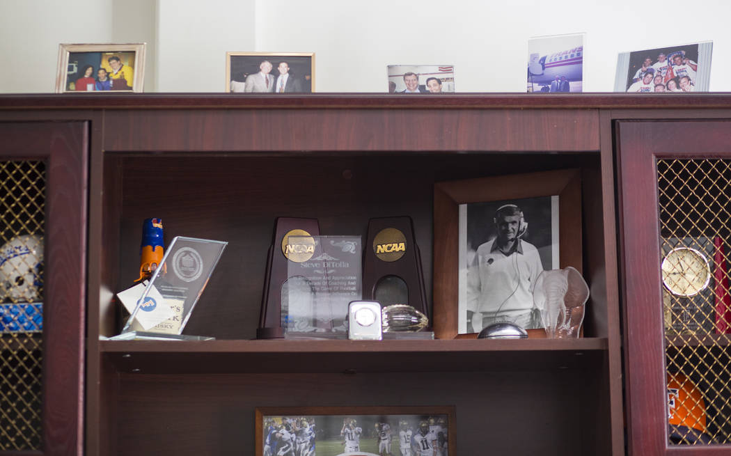 A photo of Titan football head coach Gene Murphy, right, in the office of Steve DiTolla, senior associate athletic director at Cal State Fullerton, on campus in Fullerton, Calif. on Wednesday, Oct ...